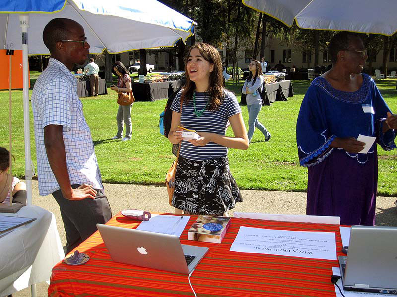 Dr. Nyamora (LEFT) listening to one of the many visitors at Endurance during the Mills College Health Fair