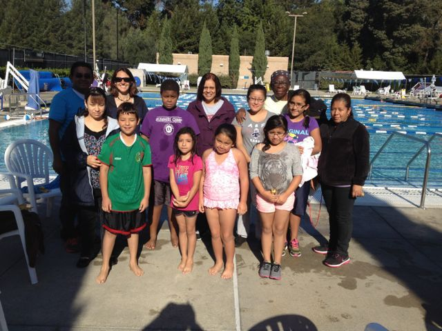 California kids with their families after a swimming training organized by Endurance - a Sports and Psychology Center at Mills College