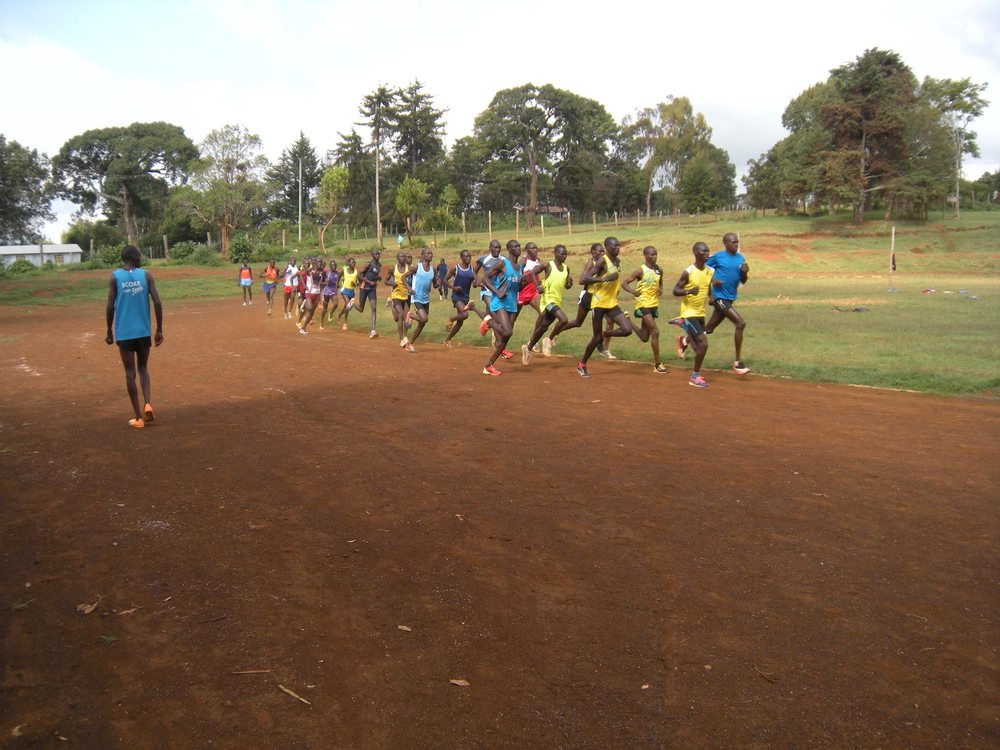 Kenyan runners training on the track in Iten.