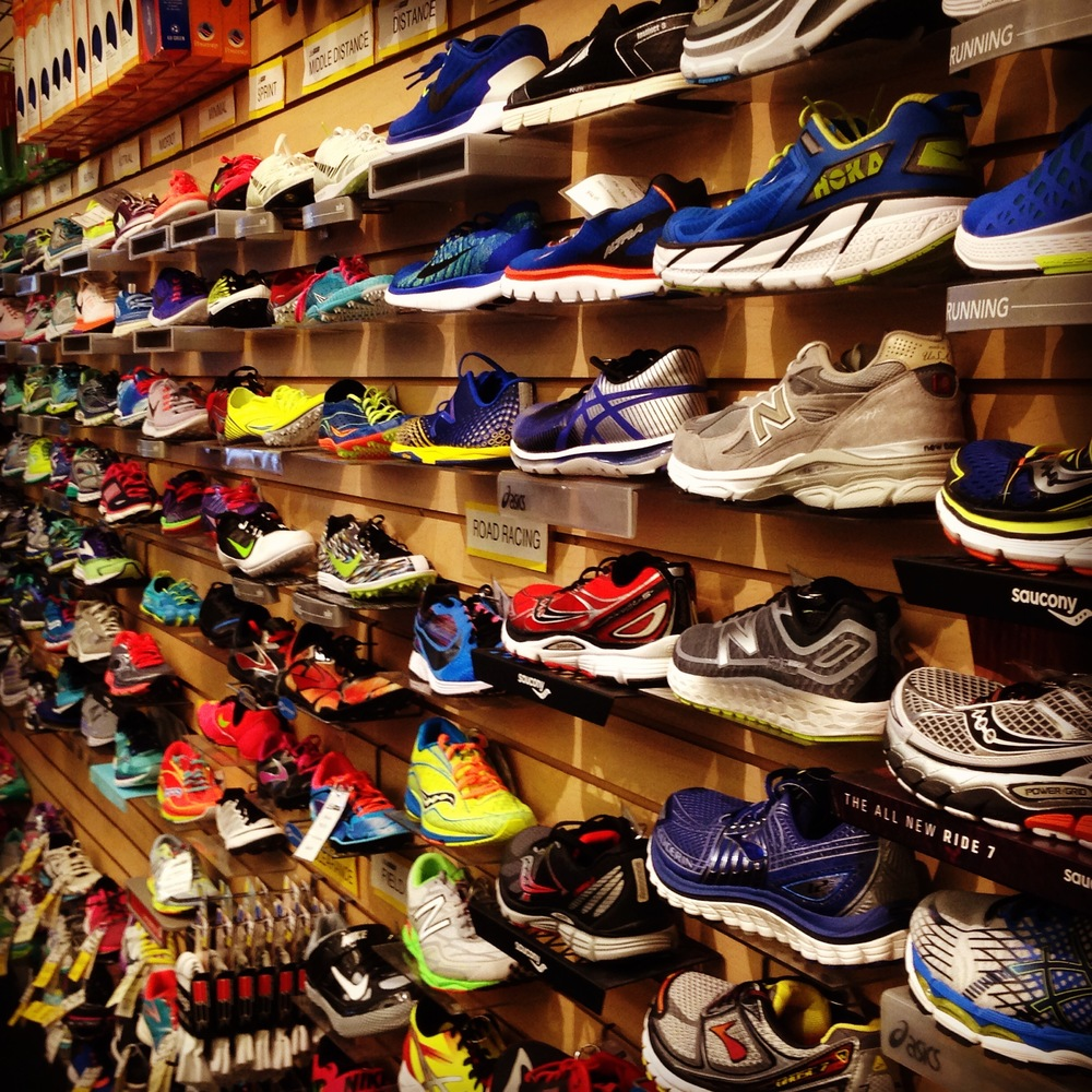 Wall containing many types and styles of athletic shoes