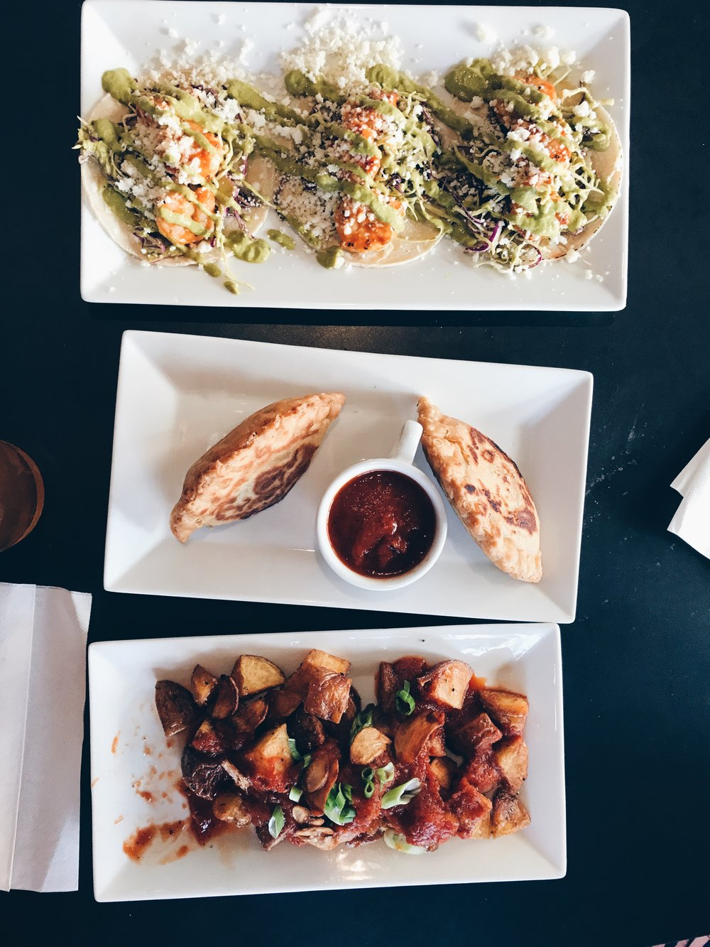Top to bottom: Spicy Shrimp Tacos, Beef and Chicken Empanadas, Patatas Bravas