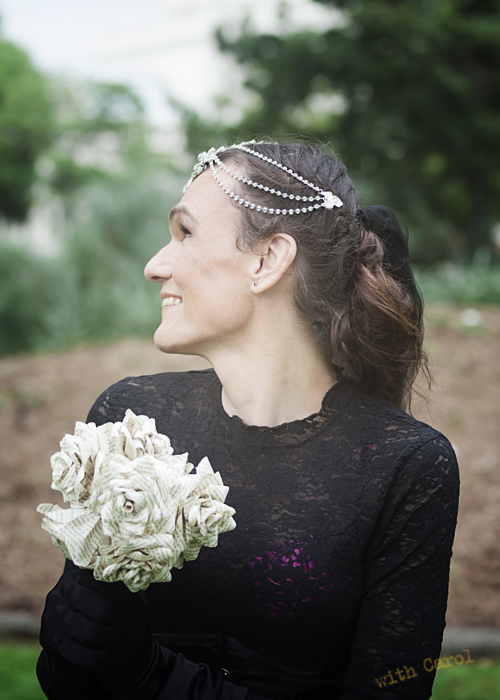 Ms T, her elegant black outfit showing a cheeky peek of an amazing pink underwear collection. The matching handmade paper bouquets were the perfect accent for the two contrasting outfits that the brides chose.