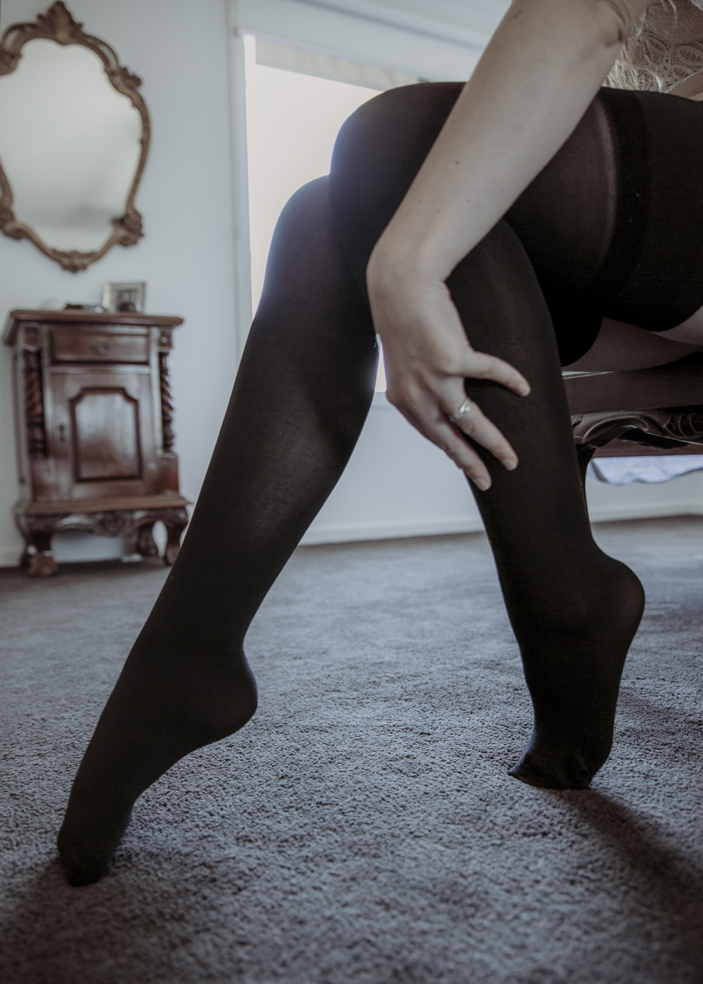 Anonymous boudoir sexy legs in stockings