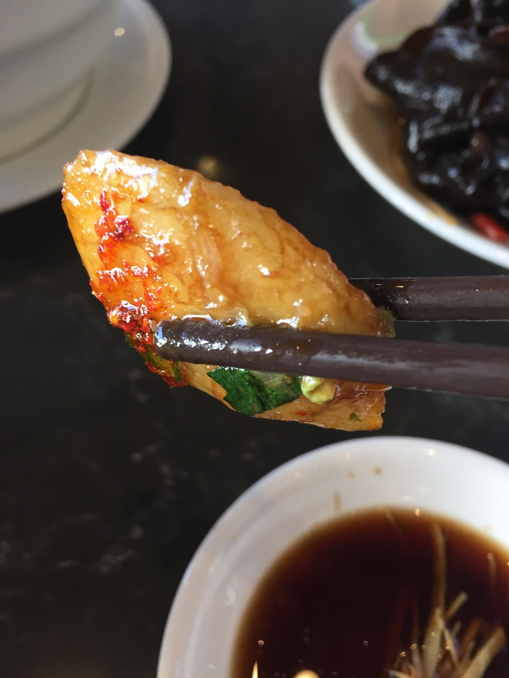 Vegetarian Shanghai Rice Cakes, shown served with house chili oil.