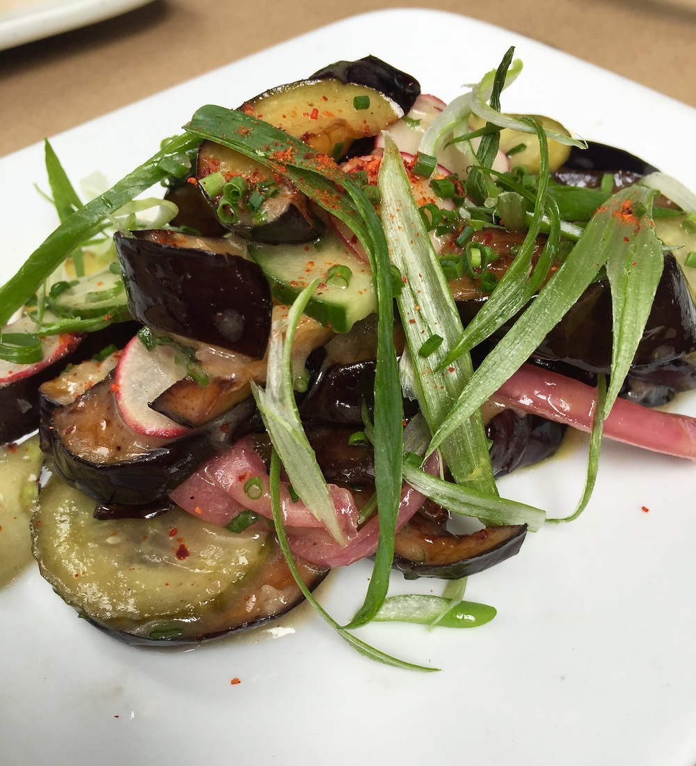 Baco Mercat's Eggplant with radish, pickled onions, and cucumbers