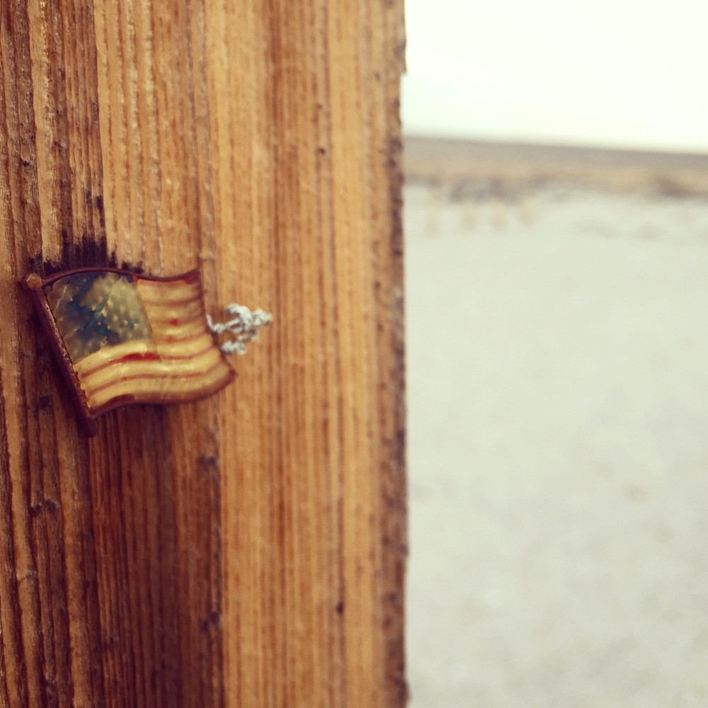 Flag pinned to a post at Manzanar cemetery