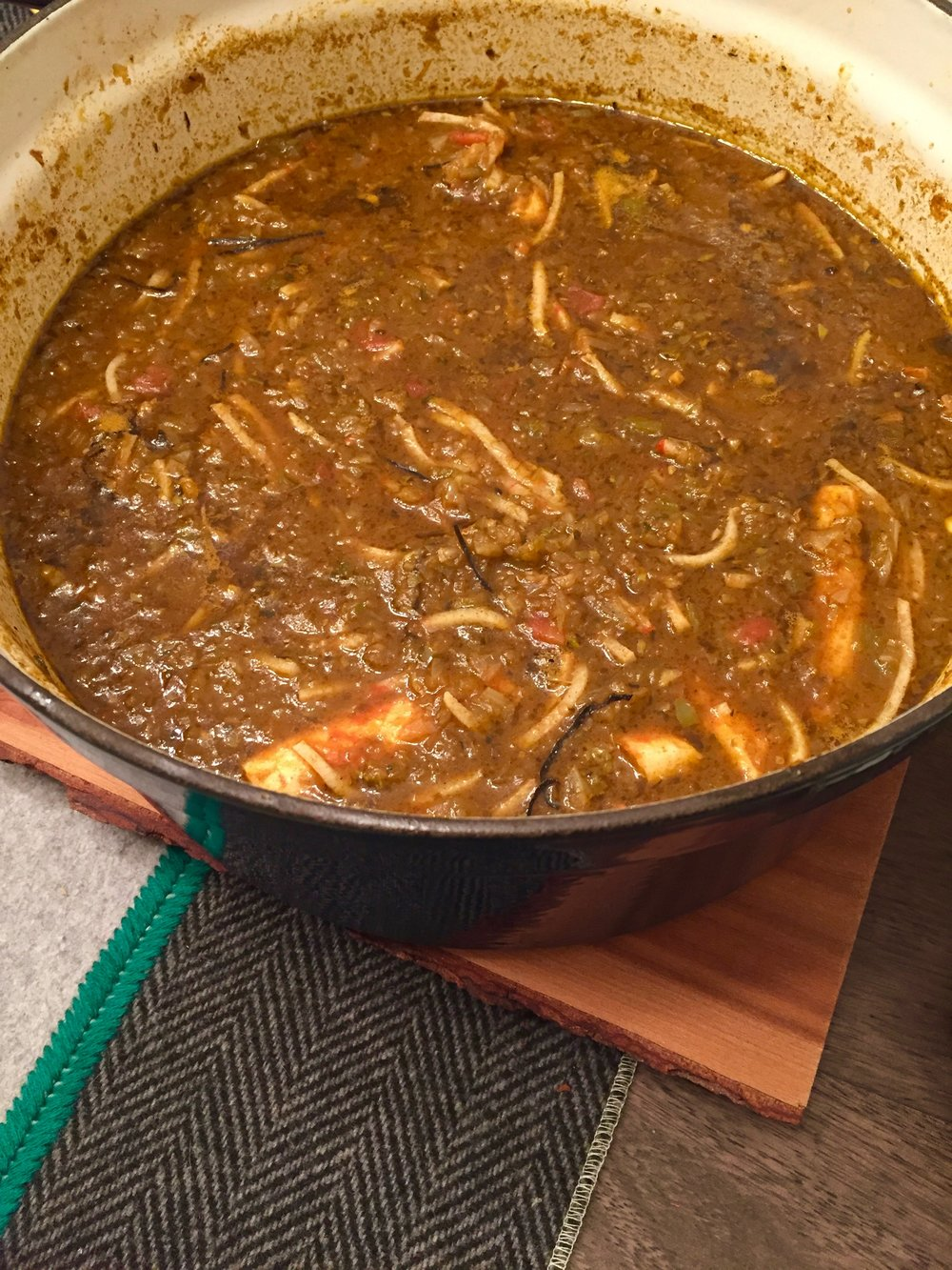Protein is added to the gumbo base approximately 10 minutes before serving. If you're making a seafood version, allow just enough time to bring meat up to proper temperature without overcooking.