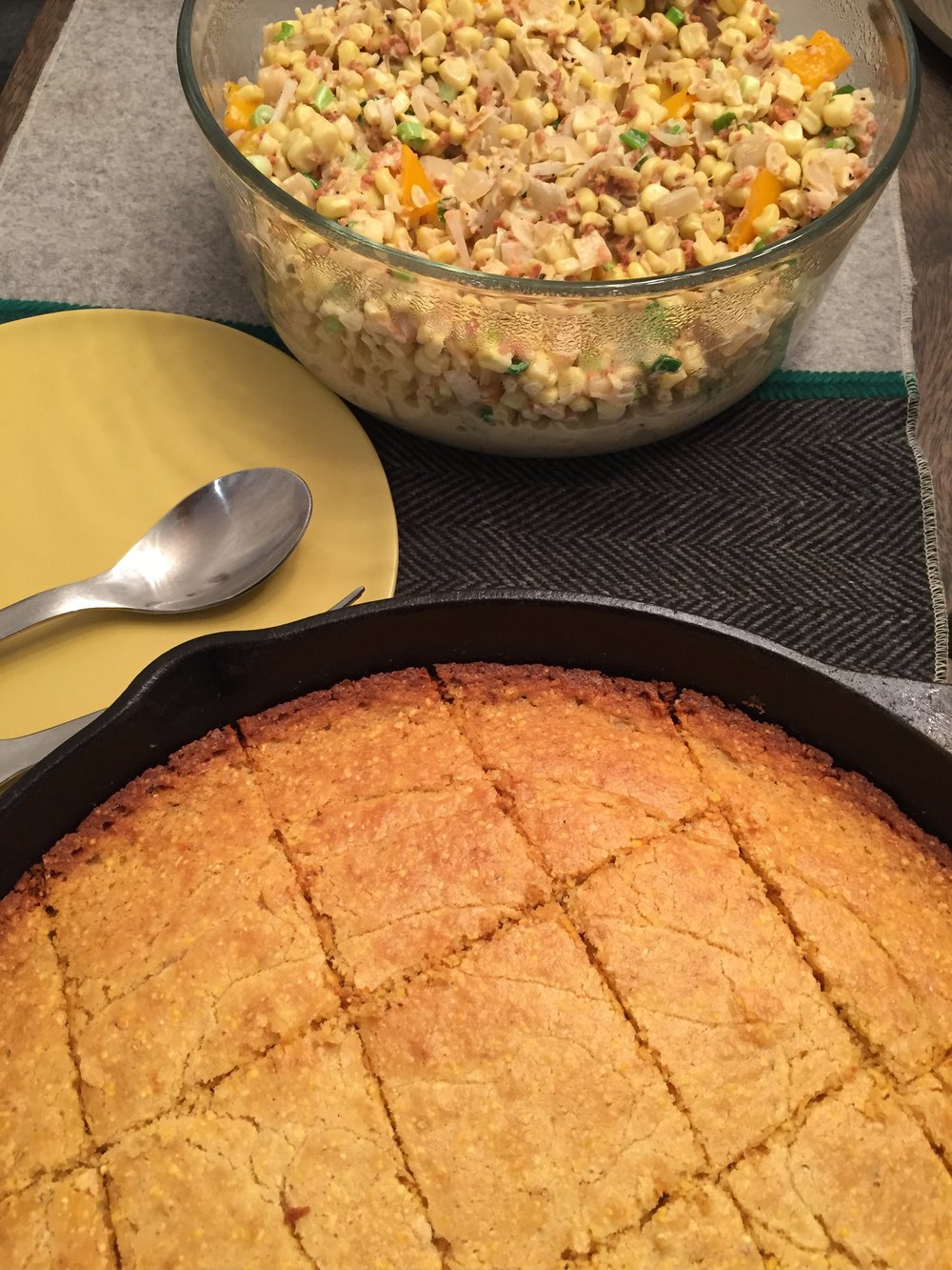 Served with a side of vegetarian corn maque choux, and skillet corn bread.
