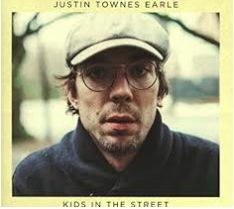 Justin Townes Earle  -  Kids In The Street   This must be what it's like to stand alone on a Memphis street corner on a windy gray October Sunday afternoon with a guitar strapped across your back and no particular place to go. Listen:  Maybe A Moment, Kids In The Street