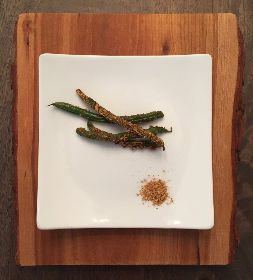 Pan-seared green beans with char salt and lemon zest.