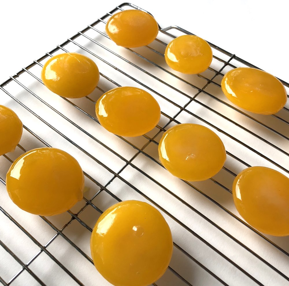 They are placed on an oiled wire rack to bake.