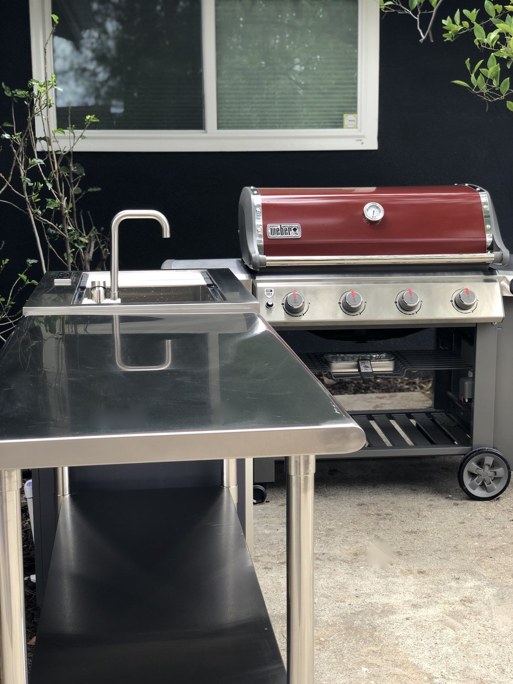 Our new outdoor kitchen consists of a stainless steel work table, a sink with waste water that flows to a nearby orange tree, and a Weber Genesis II E-410 grill. Our next addition will hopefully be an outdoor wok.