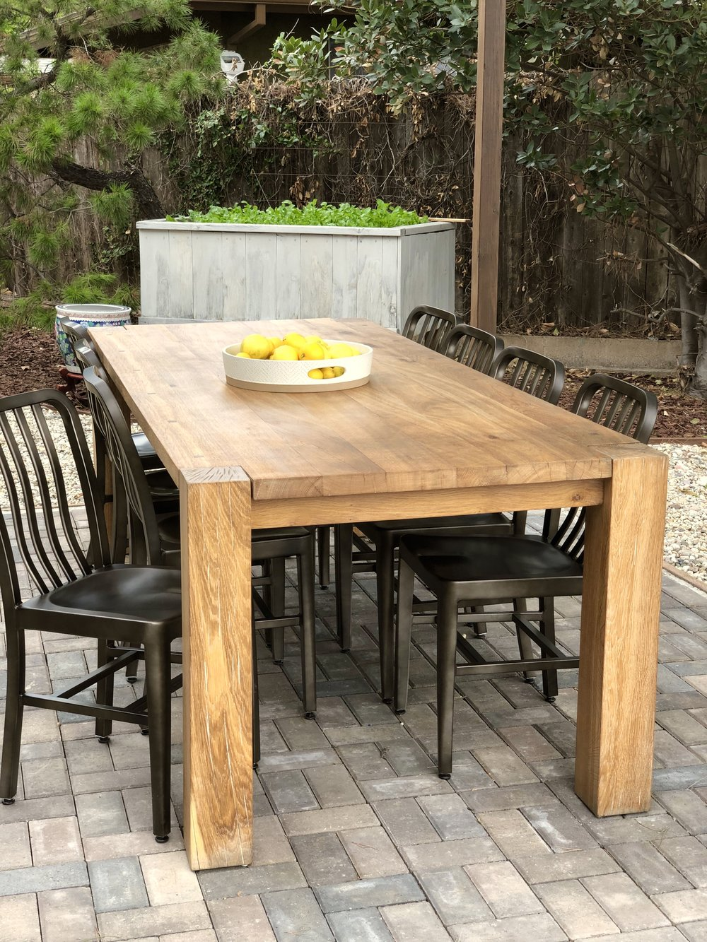 Our 10-seat dining table was the luckiest of lucky finds. Crate & Barrel's Big Sur oak table retails for $1900 but we found one at an estate sale for only $300. I refinished it with Epifanes Matte Wood Finish, which is an incredible marine strength coating that transformed this indoor piece into an outdoor one.