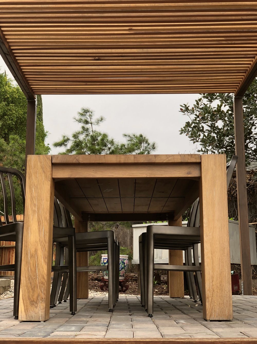 We created the pergola roof from durable redwood slats that let in just enough light.
