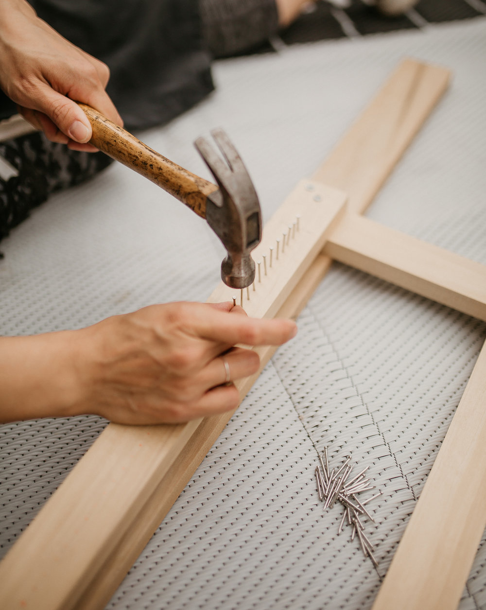 g. Then hammer away! Be sure to use finishing nails so that the weaving will be relatively easy to take off the loom when you're finished.