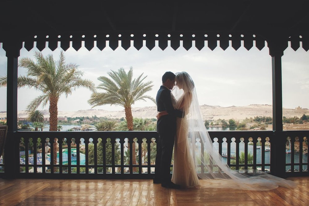 The couple on the veranda overlooking the majestic Nile River.