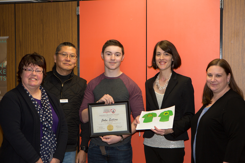 Howell High school student john sellers wins the 2015 Dragon run art contest and is presented with a certificate by lunar new year subcommittee members:: donna olsen, richard lim, cathleen edgerly, kate litwin.