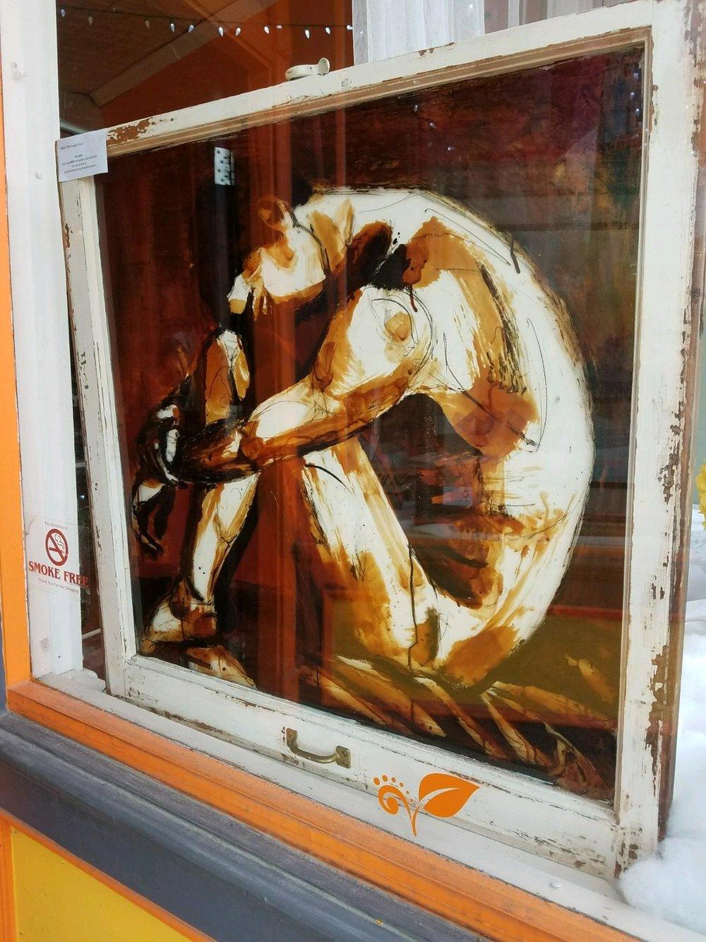 Hanged man art at Kokopellis.jpg