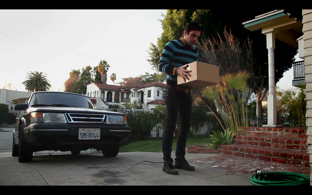 zach with package.png