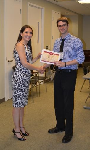 Rhea Owens presents Blake with his award at the 2014 APA Convention