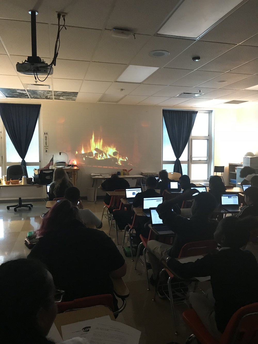 Mrs. Clarks students working hard on a rainy day in front of a roaring fire