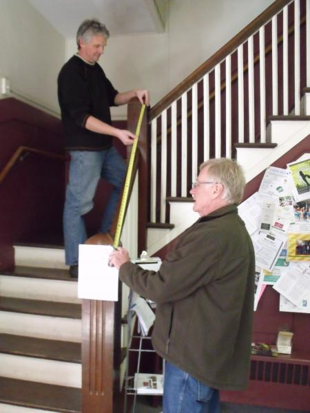 Photo Caption:  L-R Chris Farley, Senior Architect and Project Manager, and Bill Austin, Principal of Austin Design Inc.  begin measurements at Hitchcock to kickoff the process of evaluating the possibilities for the location of an elevator at Hitchcock.