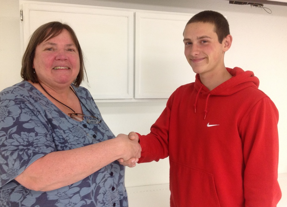 Hitchcock Director Susan Gregory thanks Dom Zollo for choosing a project at Hitchcock to complete for his Eagle Scout project.