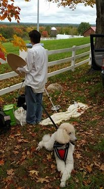 New Hitchcock art instructor, Laura Cenedella, with her assistance dog, Crystal, enjoy Plein air painting time at a farm.