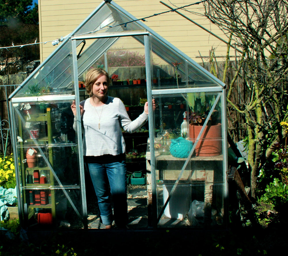 Me, post-cancer, in my tiny greenhouse in San Francisco.