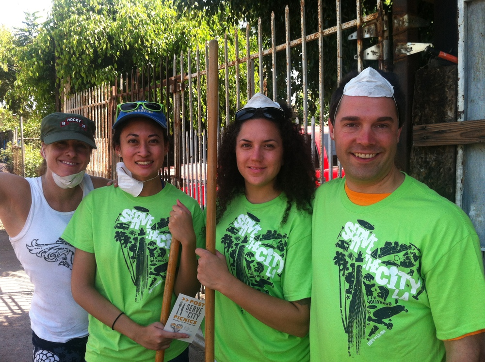 TMG volunteering at a community clean up during the Serve the City event!