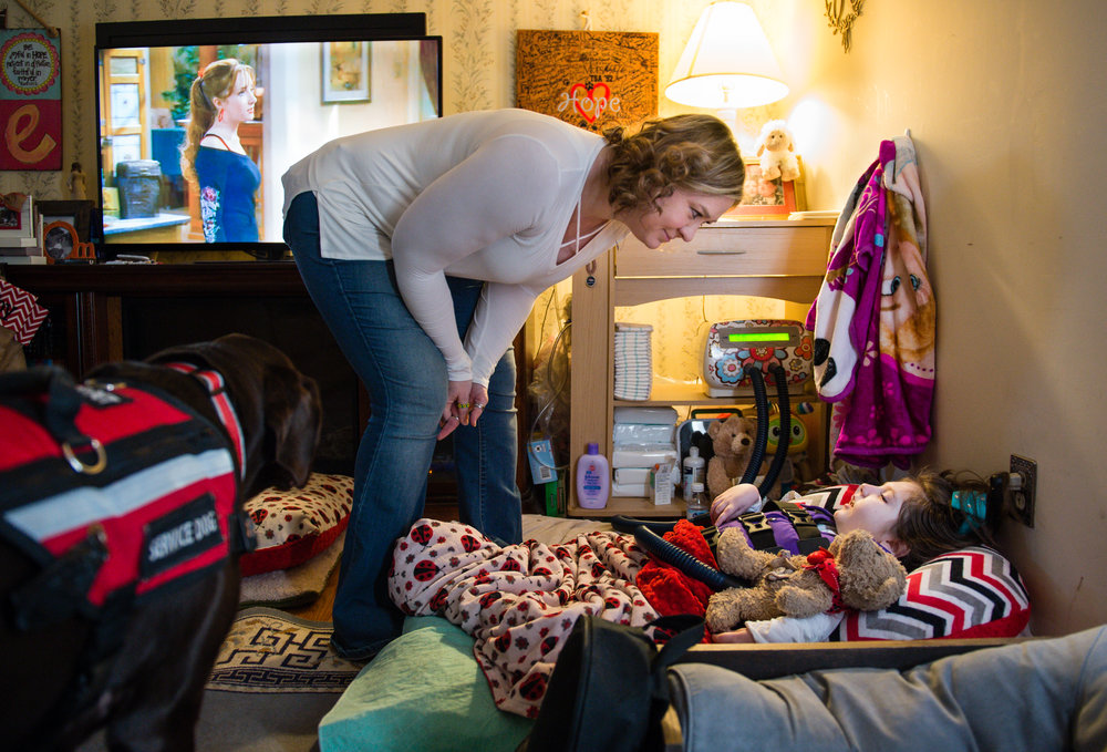 Janea Cox talks to daughter Haleigh, 7, as she cares for her at their temporary quarters in Forsyth, Ga., Friday, Feb. 17, 2017. They are currently rebuilding their own home after it burned down in July 2015, and hope to move soon.