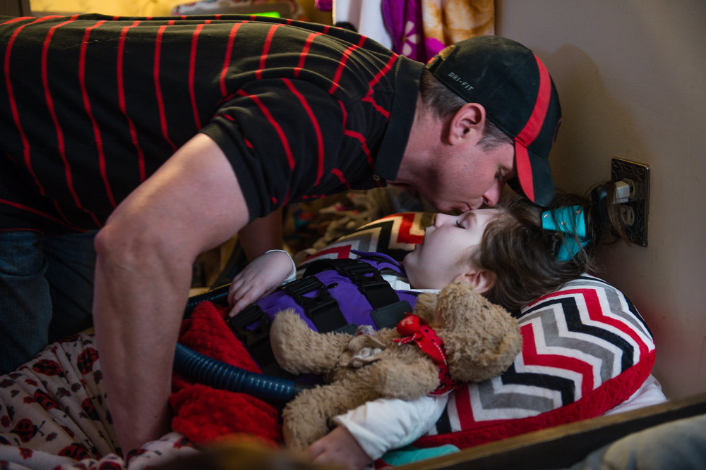 Brian kisses his daughter Haleigh as he greets her in the afternoon.
