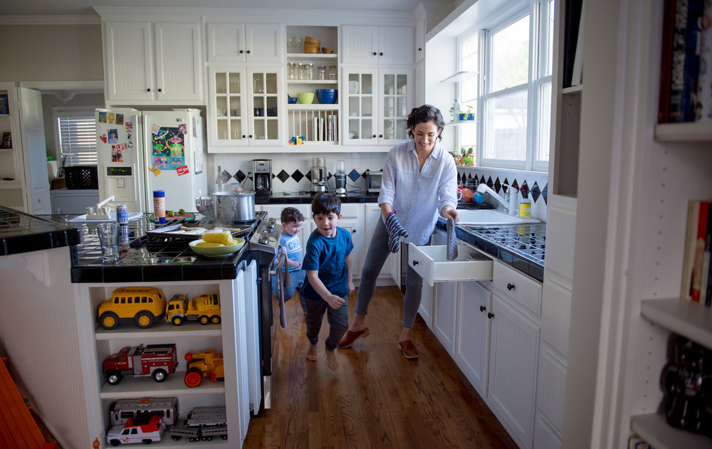 030418 DECATUR � Zoe Fishman Shacham prepares dinner for sons Ari, 6, and Lev, 2, as they dance around the kitchen of their Decatur home Sunday afternoon, March 3, 2018.