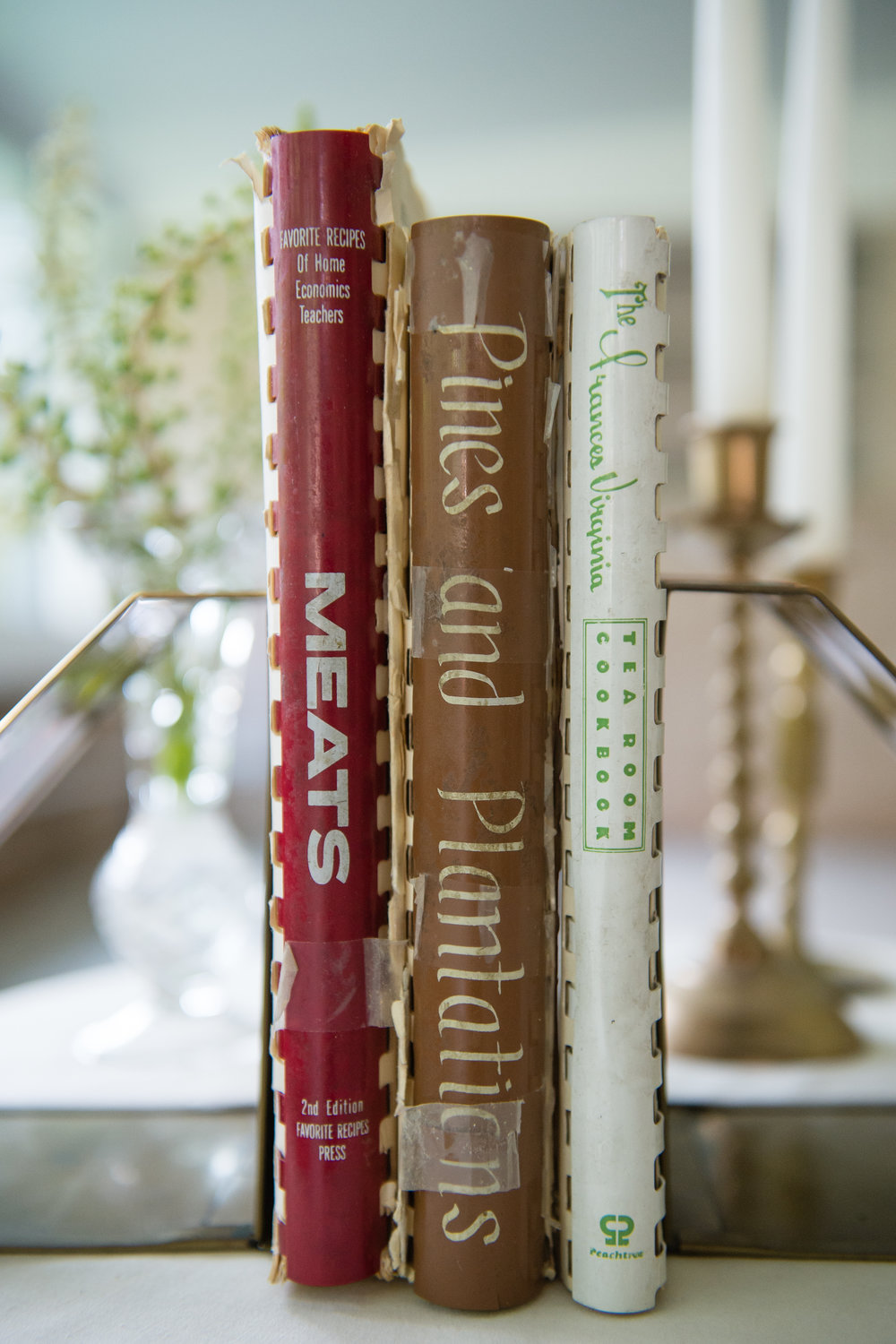 Cookbooks, flanked by crystal and candlesticks, all of which belonged to Lucille Burton, great aunt to Rosalind Bentley and mother to Bentley's second cousin Brenda Webb.