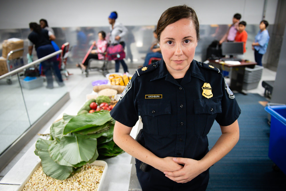 Tasha Mashburn, Agriculture Supervisor for U.S. Customs and Border Protection, poses for a photo near some agricultural contraband her team confiscated from the luggage of international travelers arriving at Hartsfield Jackson Atlanta International Airport Tuesday, 25 Sept. 2018.