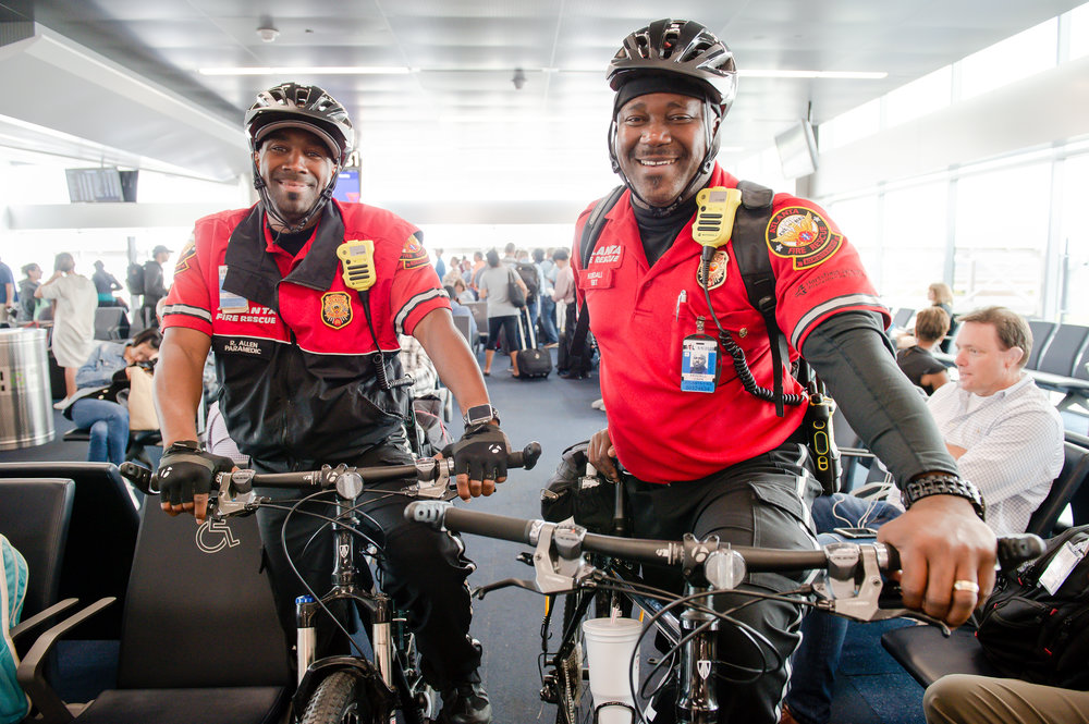 (From left) EMS Bike Medics Rayshawn Allen and Kendall Gavin pose for a photo at the far end of Concourse B at Hartsfield Jackson Atlanta International Airport Friday, 28 Sept. 2018.