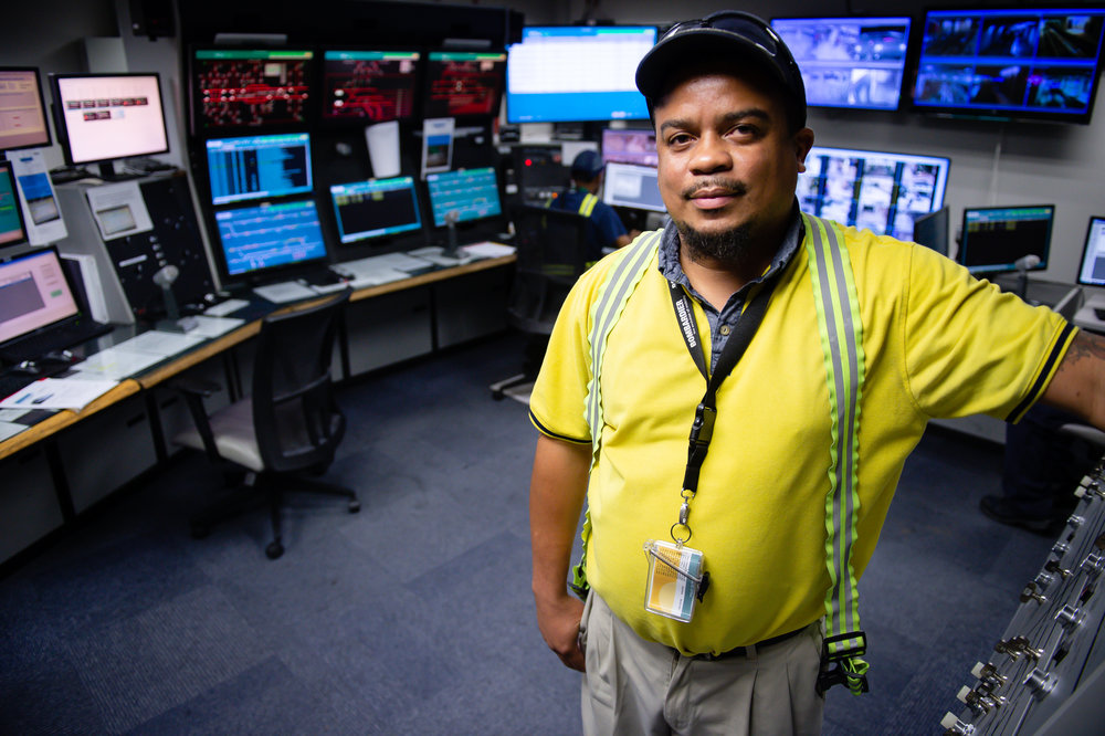 Calvin Tisdale, operation and maintenance manager of the Plane Train, poses for a photo in the control room at Hartsfield Jackson Atlanta International Airport Friday, 28 Sept. 2018.