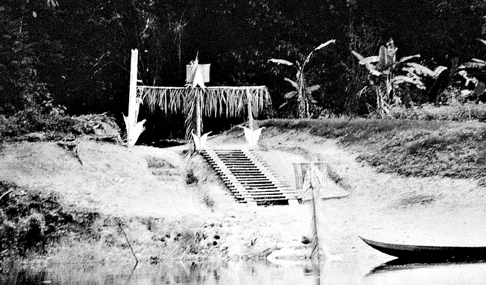 Original photo of gate into village along the Landon strip, Awarradam  S aramaccaners believe that you are cleansed from negativity by walking underneath them and it keeps bad spirits from entering. .