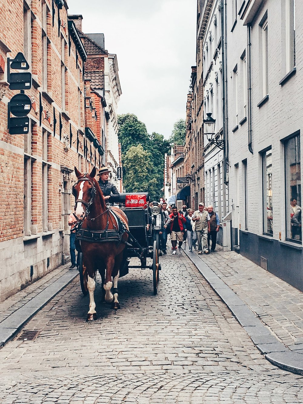 The horse-drawn carriages are very poular with tourists. A 35-minute tour costs about 50 Euros (Bruges, Belgium)