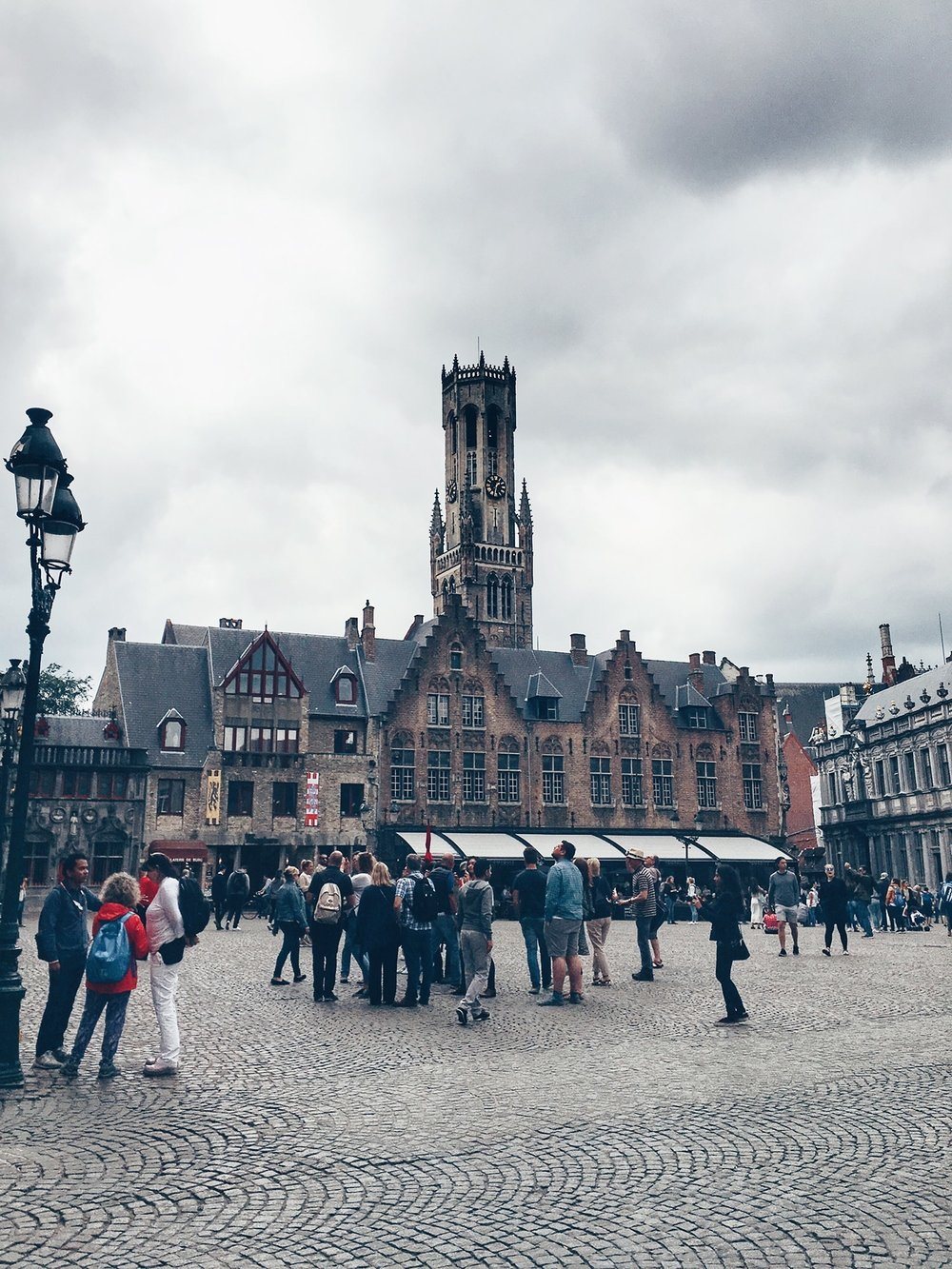 The Markt with its most distinctive sight, the Belfort. The small, unassuming house in the left hand corner is the Basilica of the Holy Blood (Bruges, Belgium)