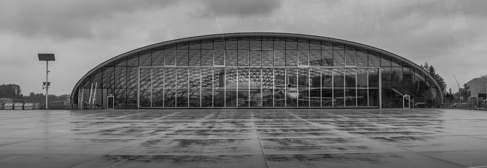 Panorama of the Red Bull Hangar 7 shot on Fujifilm X-E1 with Olympus 50mm f1.8 @ 1/1000 f5.6 ISO 400 and then stitched together using the panorama feature in Adobe Lightroom CC