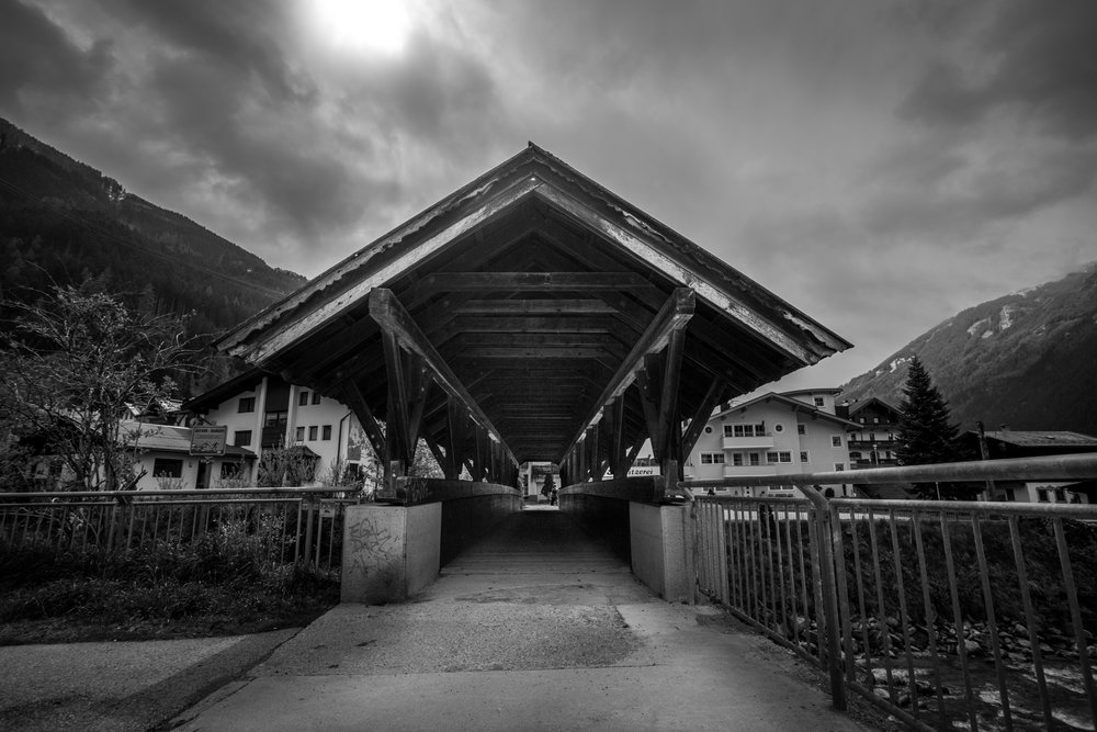 old wood bridge with alpine roof