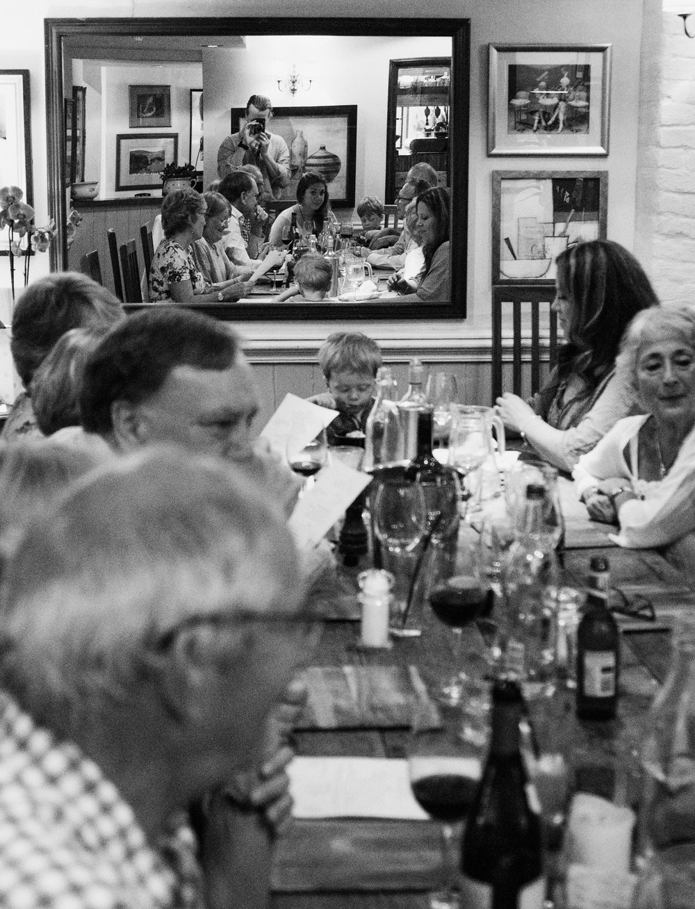 My Family and friends at my mums 70th birthday lunch, please note the smallest member of the family at the head of the table. Shot on the Fujifim X-E1 with post in Lightroom Classic