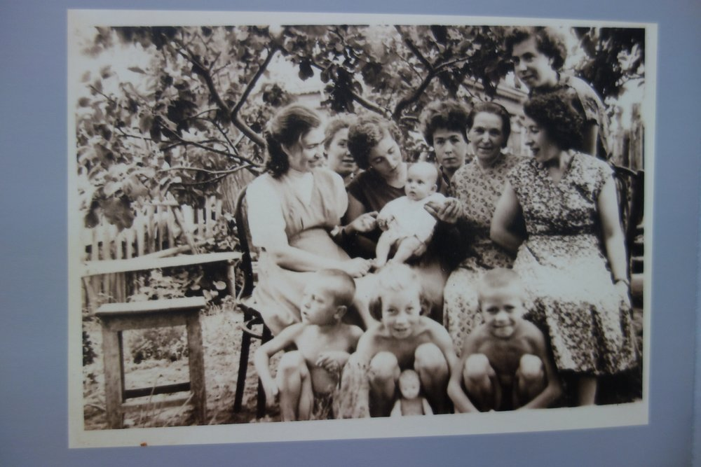 3 generations: My grandmother Polya, her daughters Masha, Liza, Lyuba, Valya, Ira Zoya (my mother, top right) and their children