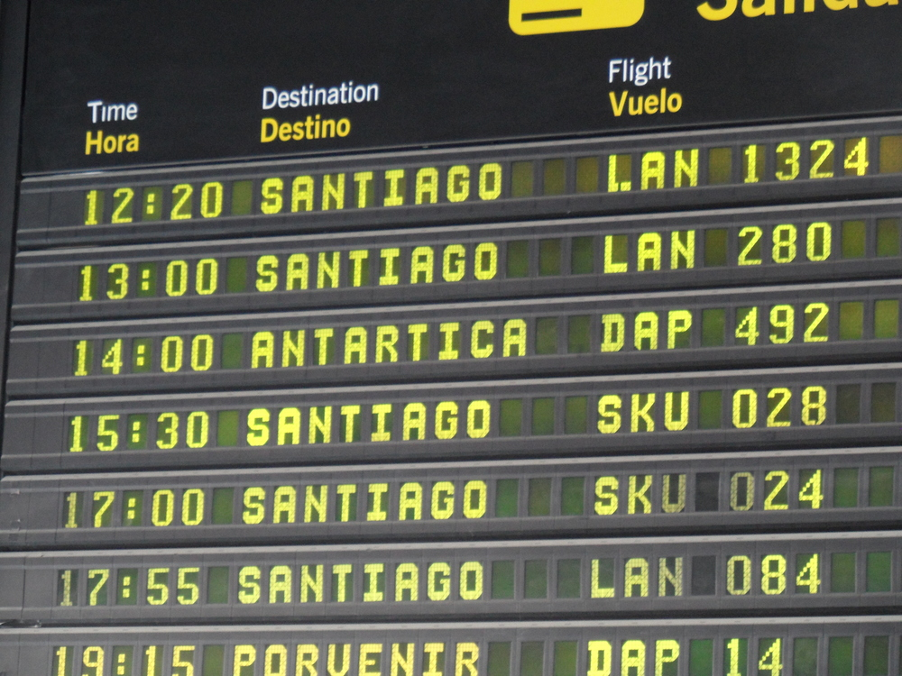 Departure board at Punta Arenas Airport. There's our flight ... DAP 492 to Antarctica!
