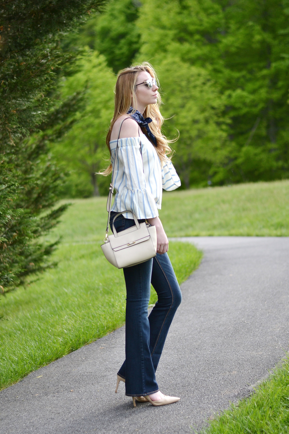 Off-The Shoulder Top & Flared Jeans (via Chic Now)