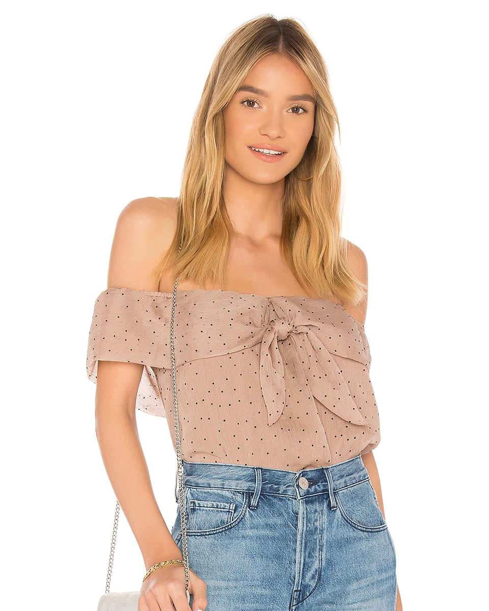 THE SWEET SIDE - If sweet and soft is more your vibe this Valentine's Day, I really like this pink-y mauve off-the-shoulder top. Pair with a dainty necklace or some bold earrings to complete the look.