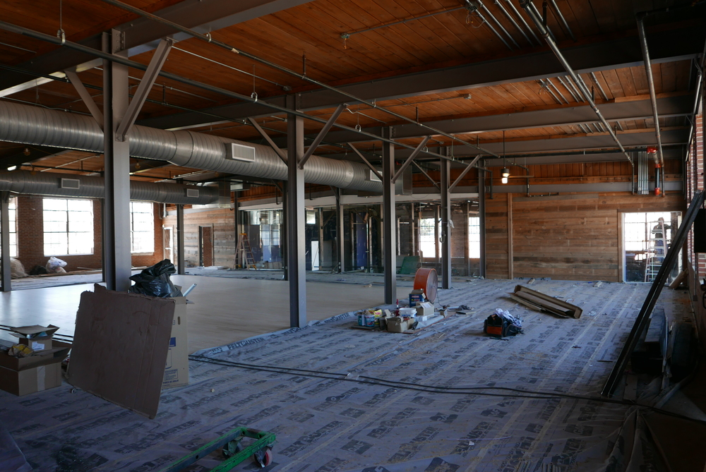 The event space with dance floor. Looking through the storefront to the distillery.