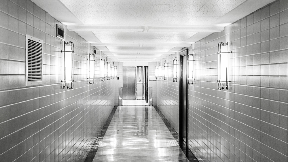 pexels-black-and-white-tiles-clean-corridor.jpg