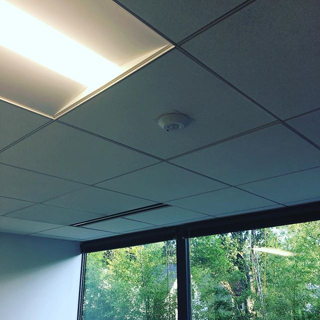 Our Kensington conference room was just fit-out with new Lutron LED lights, a new wall-mounted dimmer switch, and a combination daylight and occupancy sensor! The sensor will dim the lights to maintain a lighting level as outdoor light varies!